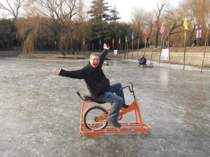 Student on exercise bike on frozen lake