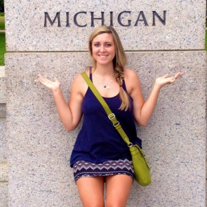 Rachel Hartman standing next to a pillar that says Michigan