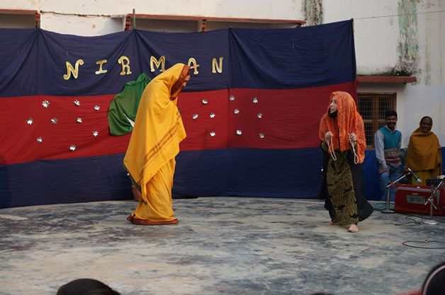 Two women on stage performing a scene from Ramayana