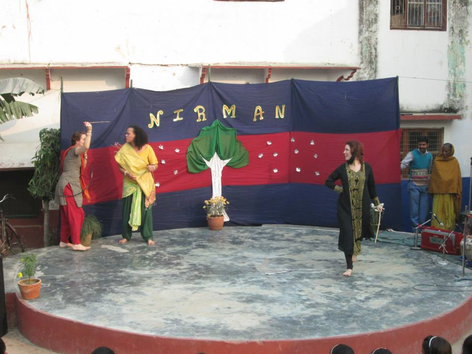 Three woman performing a scene from the ancient Indian poem Ramayana