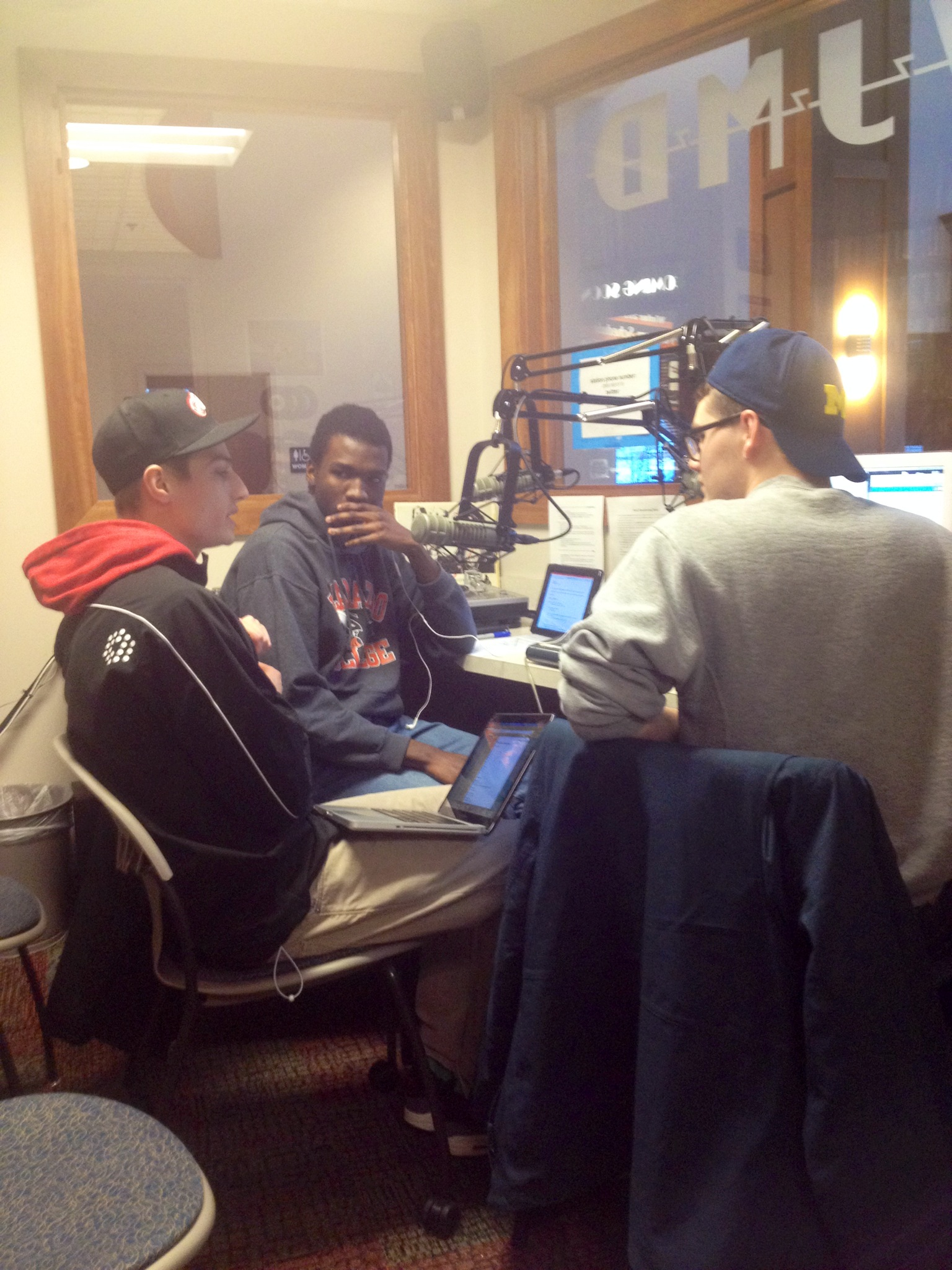Three students at a radio station