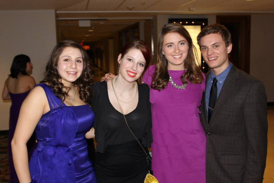 Four students smiling at Monte Carlo night