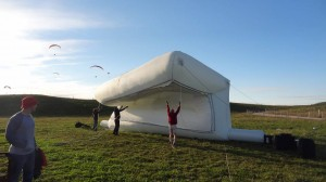 People in a field with a giant inflatable object