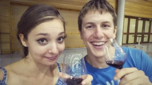 Two college students drinking wine