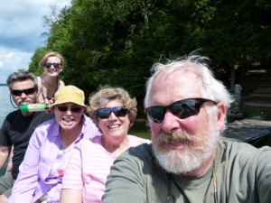 A group of adults hanging out on a lake