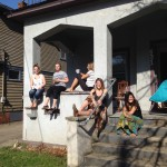 Students sitting on an off-campus porch in spring