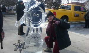 Qynce Chumley K '19 poses with an ice sculpture.