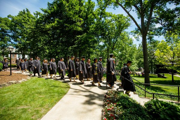 Manage Student Loans Graduates Walking on Campus