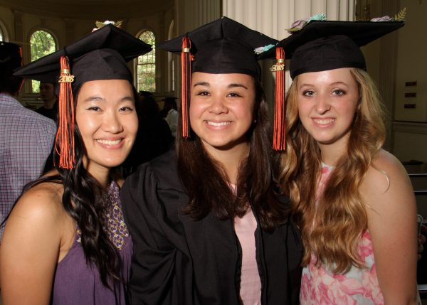 three girls in graduation caps