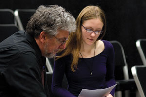 A faculty member consults with a student on their paper.