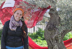 Aubrey Parker '08 with a 200-year-old olive tree that was named in her honor