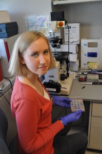 Intern Kaitlyn Greiner works in a lab