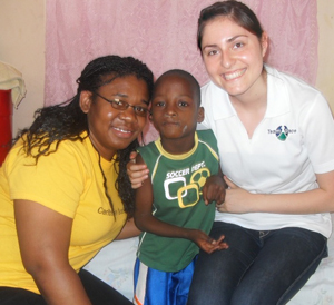 Roxann Lawrence and Amy Jimenez with a young patient in Haiti