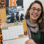 "K Senior Shoshana Schultz hold ""A Year of Food in Kalamazoo,"" a calendar created by her and other K students."
