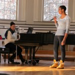 "Willina Cain '15 sings ""Wake Up Everybody"" while Corrine Taborn '13 accompanies."