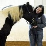 Kalamazoo Senior Ashleigh Holden poses with a horse