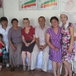 Britta Seifert ''12, center, poses for a photo with health educators in a village outside of Toktogul in the Kyrgyz Republic.