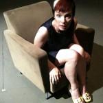 Holly Hughes in a chair
