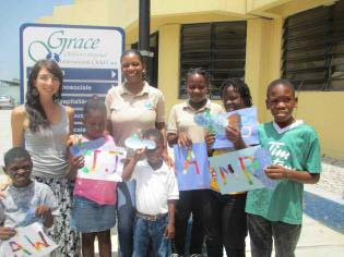 Zoe Beaudry with young students in Haiti