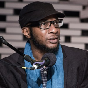 Teju Cole at a microphone