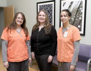 Molly (Shelter) Parker (center) with her new medical assistants at the Three Meadows Medical Plaza