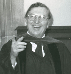 Richard L. Means dressed in commencement attire