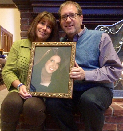 Alicia and Michael Stillman hold a picture of their deceased daughter, Emily