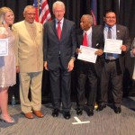Abigail Minor ''''14 is pictured at far left with President Clinton and other award recipients at the April 26 Democratic Party dinner in Detroit.