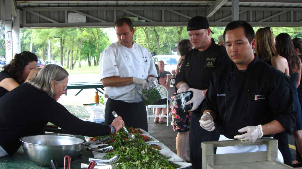 Chef James Chantanasombut (far right) assembles soybean and cabbage cake