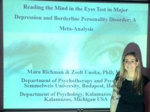 Senior psychology major Mara Richman in front of a projection screen