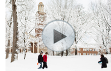 Students walking near a snow-covered Stetson Chapel