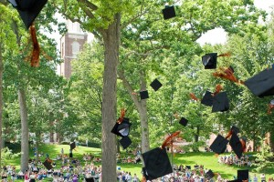Graduation caps are thrown in the air