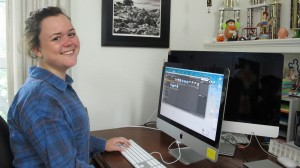 Jessie Fales smiling at a desktop computer