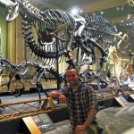 Joel Hutson ''02 with Ceratosaurus Carnotaurus at the Dinosaur Discovery Museum of Kenosha, Wisc.