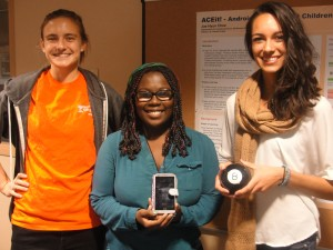 K students (l-r) Natalie Davenport '16, Octavia Smith '18 and Melany Diaz '16 showed local 6th- and 7th-grade girls that there is no magic to learning computer science.
