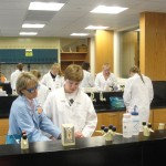 Students and professor working in a lab