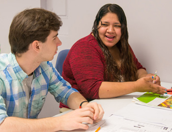 K student Andrew Parsons '19 helps Goodwill student Estefani Rosales with her GED studies