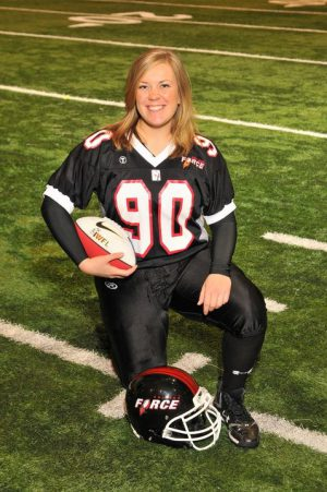 Women's Football Champion Liz Okey kneels