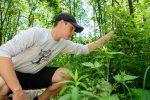 Environmental education student examining plants