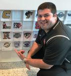 Future College Coach Brad Bez Squatting Next to Logos