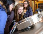 Students look inside kettles at Bell's Brewery tour