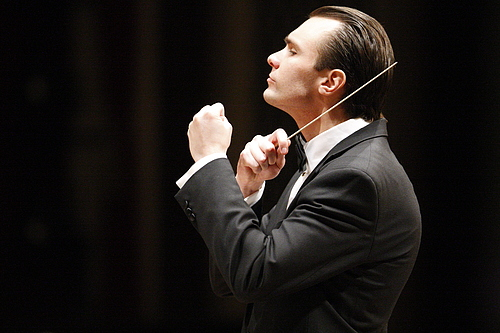 Community Medal of Arts Recipient Andrew Koehler conducting