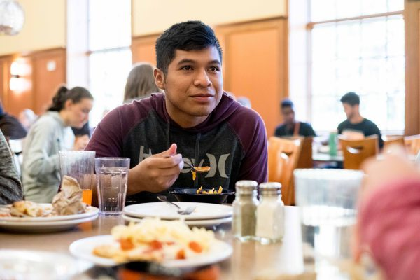 Student eating at Hicks Center cafeteria