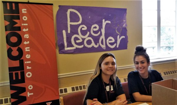 Two peer leaders assist students on move-in day