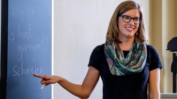 German Studies Co-Chair Kathryn Sederberg Teaches at a Blackboard