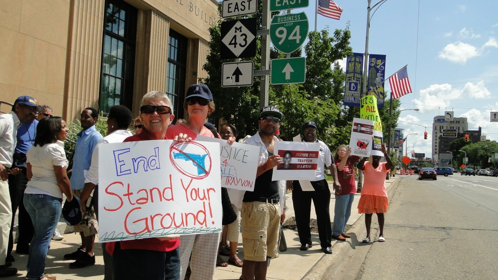 People on the side of the road in Kalamazoo, Michigan, in 2013, standing in vigil for Trayvon Martin's murder