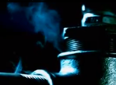 Machine spewing out blue tinted gas