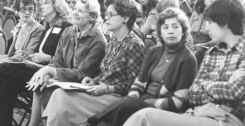 old photo of women all seated in a seminar