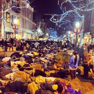 """""""die in"""" protest in Kalamazoo, Michigan, crowd of people laying on the street and sidewalks in downtown"""
