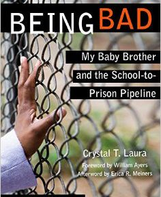 Being Bad book cover by Crystal T. Laura, hand on chain link fence